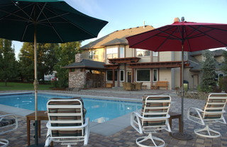 View of pool patio and outdoor kitchen traditional for Pool design boise