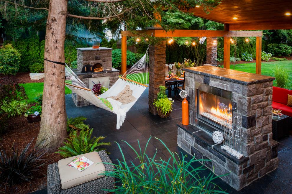 Example of a trendy patio design in Portland with a fire pit