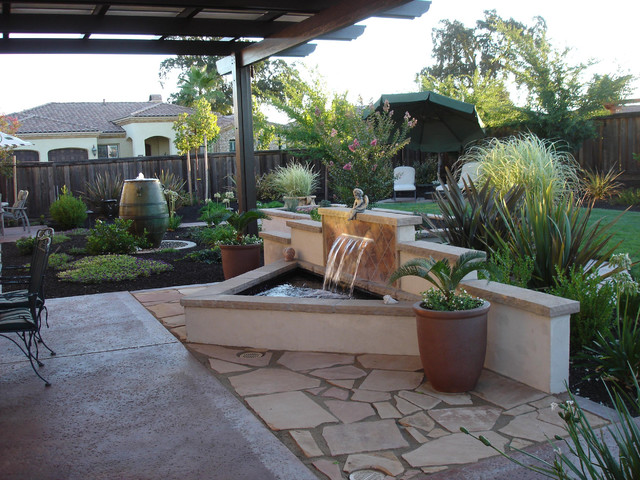Water feature with stucco and tile back splash for Stucco patio cover designs