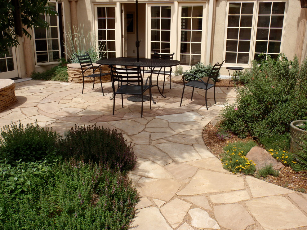 Trendy stone patio photo in Albuquerque