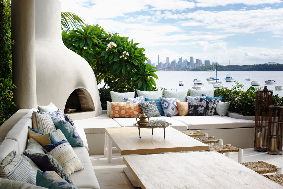 Beach style backyard patio in Sydney with no cover.