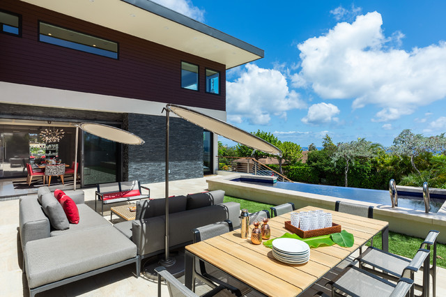 Patio - large modern backyard tile patio idea in Hawaii with no cover