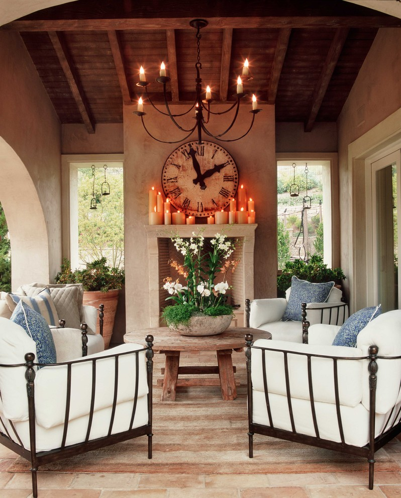Patio - mediterranean patio idea in Orange County with a fire pit and a roof extension