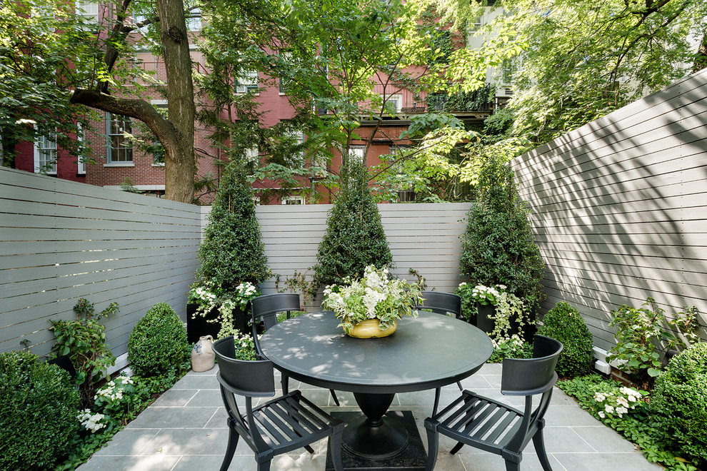 Inspiration for a small timeless backyard patio remodel in New York with no cover