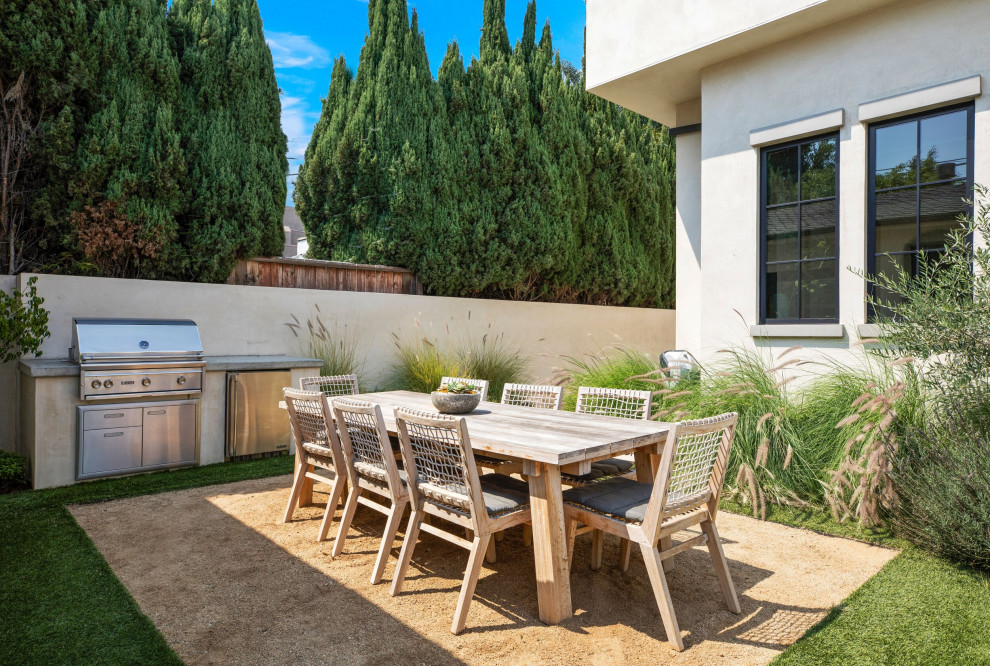 Inspiration for a large transitional courtyard patio kitchen remodel in Los Angeles with no cover