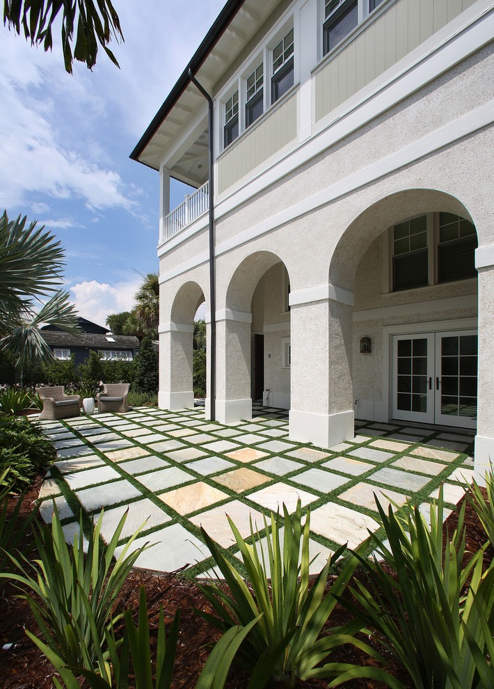 Example of an island style patio design in Tampa with no cover