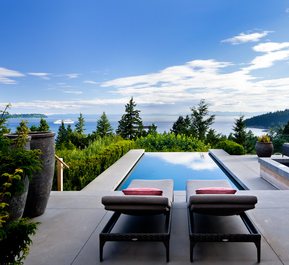 Example of a trendy concrete patio design in Vancouver with no cover