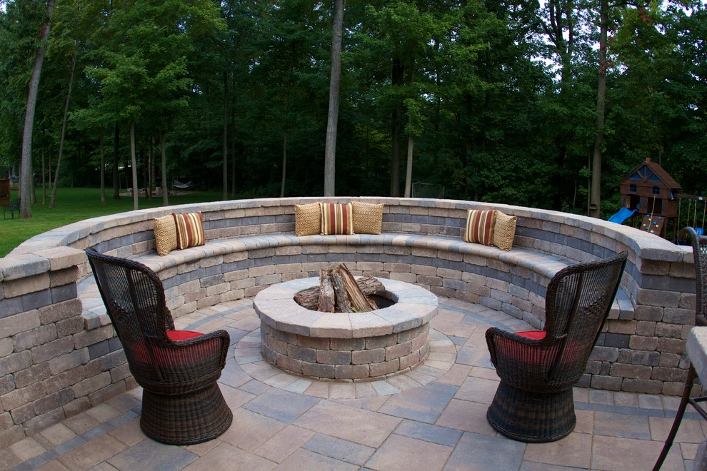 Elegant patio photo in Columbus with a fire pit