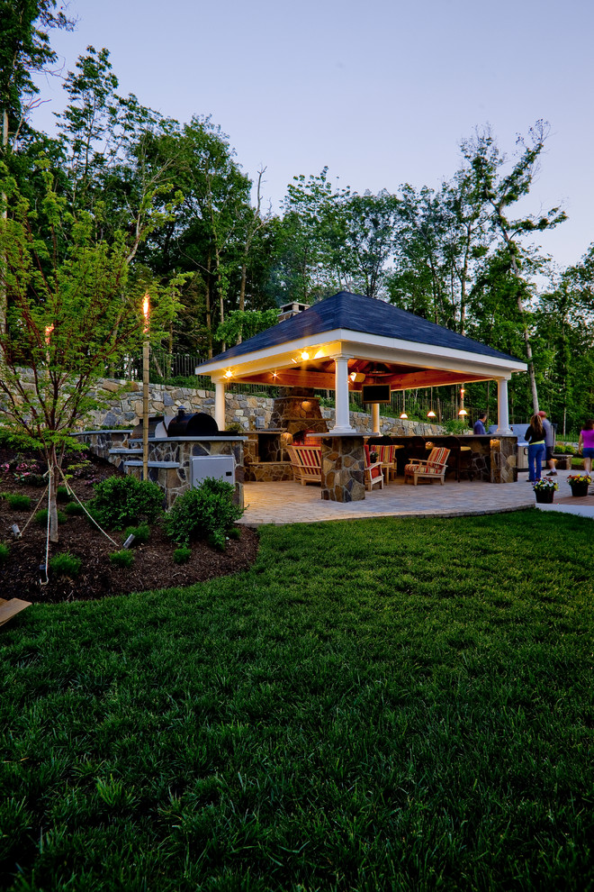 Patio - traditional backyard patio idea in DC Metro with a fireplace