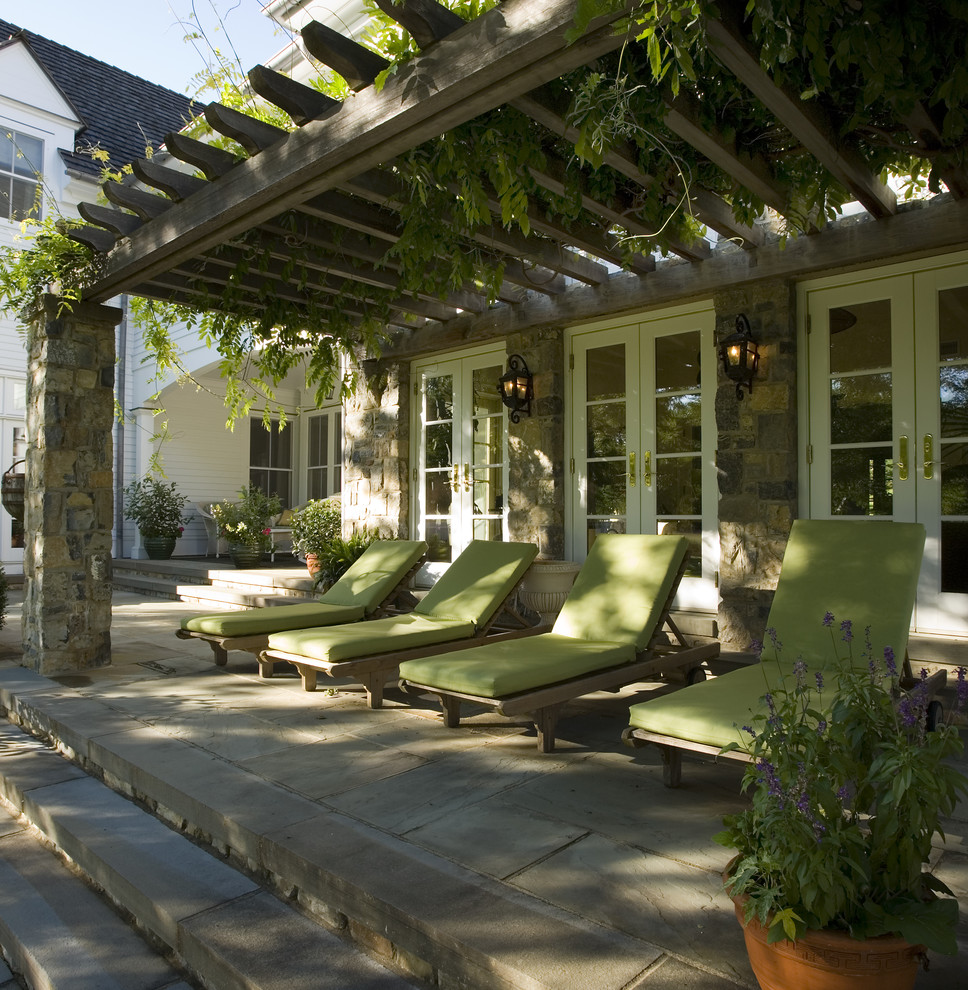 Patio - traditional patio idea in New York with a pergola