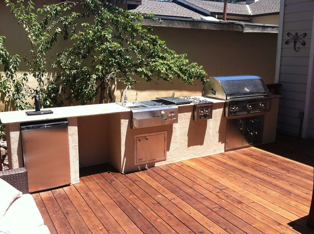 Wood Deck And Outdoor Kitchen At Rianda Traditional