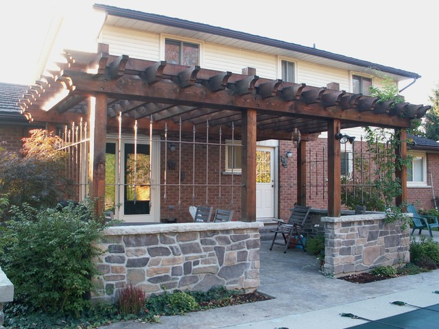 Wood Pergola With Stone Walls Traditional Patio