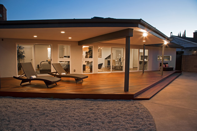 Inspiration for a large contemporary backyard patio remodel in Los Angeles with decking and a roof extension