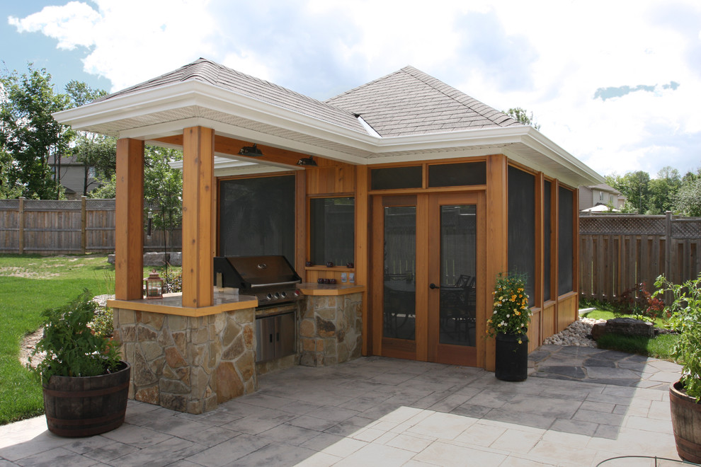 Inspiration for a tropical patio remodel in Toronto with a gazebo