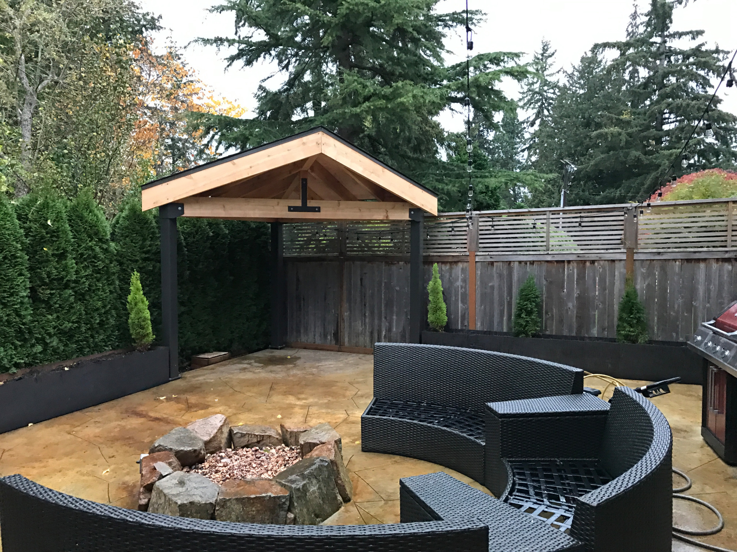 Woodwork: patio cover, patio, fire pit and steel planter beds