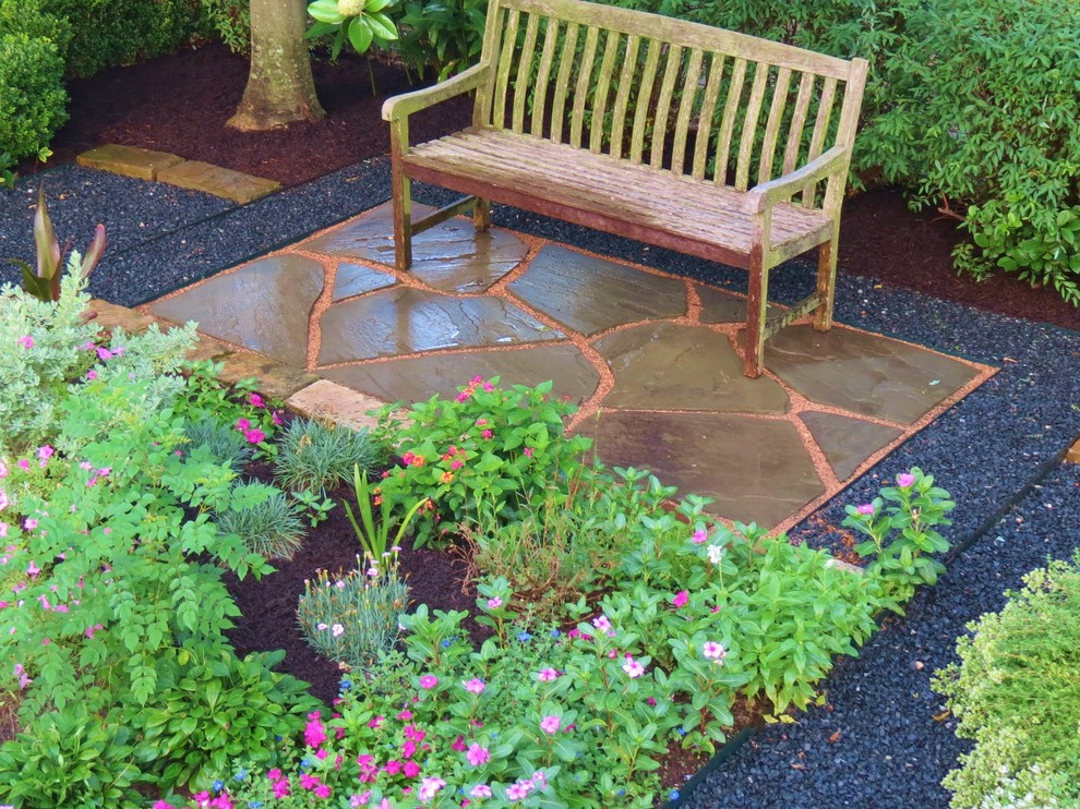 Example of an arts and crafts patio design in Houston