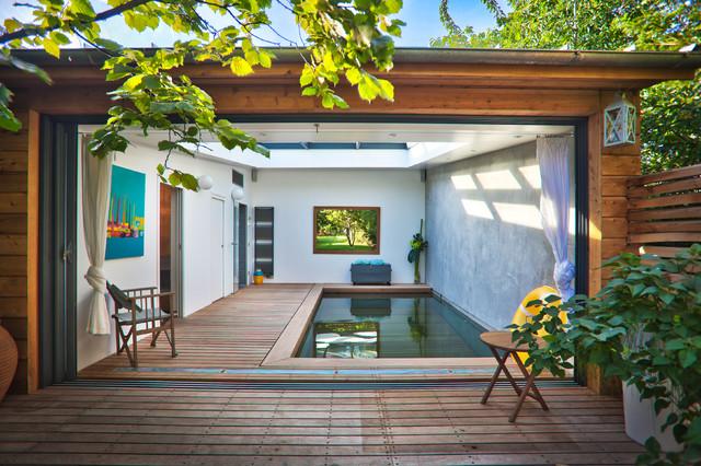 versenkbarer pool wird zur terrasse per knopfdruck bers. Black Bedroom Furniture Sets. Home Design Ideas