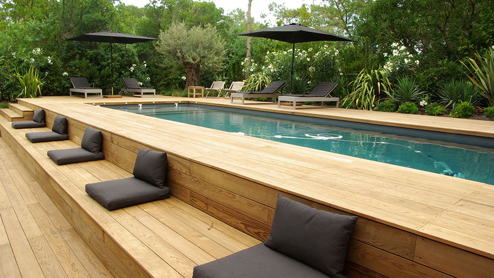 Example of a large trendy rectangular lap pool design in Bordeaux with decking