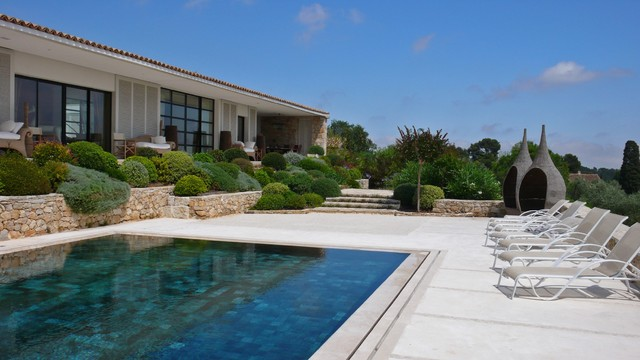 Inspiration for a large mediterranean backyard rectangular pool remodel in Nice
