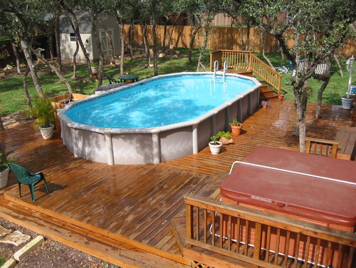 An Abover Ground Pool Surrounded By A Deck That Is Not Raised To The Level Traditional San Antonio Pools Spas Above