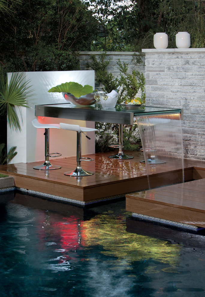 Example of a trendy pool design in Orlando with decking