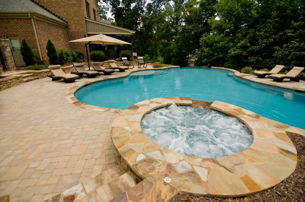 Island style pool photo in Atlanta