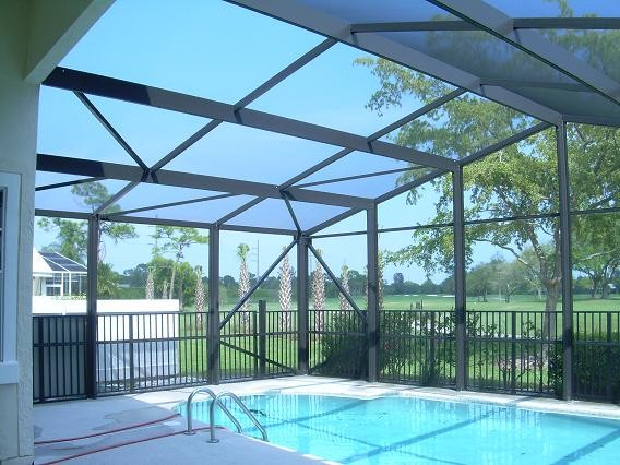 a frame style pool screen enclosure   tropical   pool