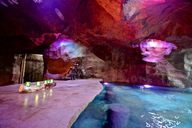 A rustic mine themed pool grotto in oklahoma rustic for Pool design okc