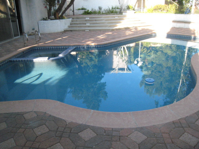 after faux painting pool coping traditional pool