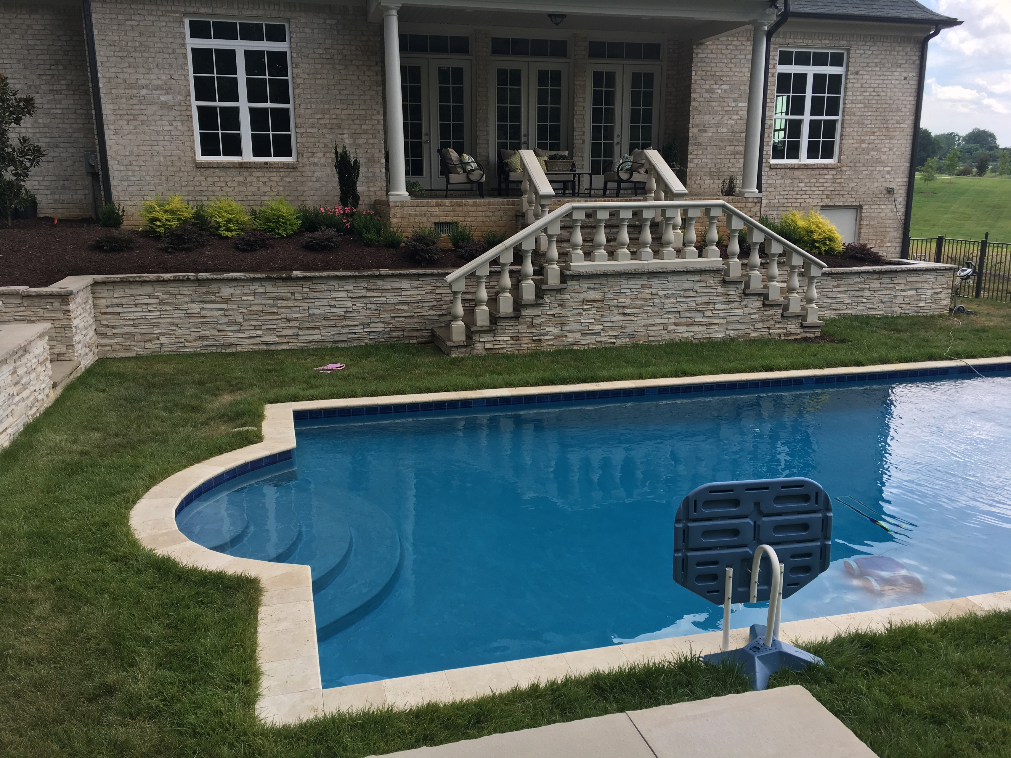 AFTER SOD & SEED PUT DOWN: Pool with firepit, english garden, large patio areas