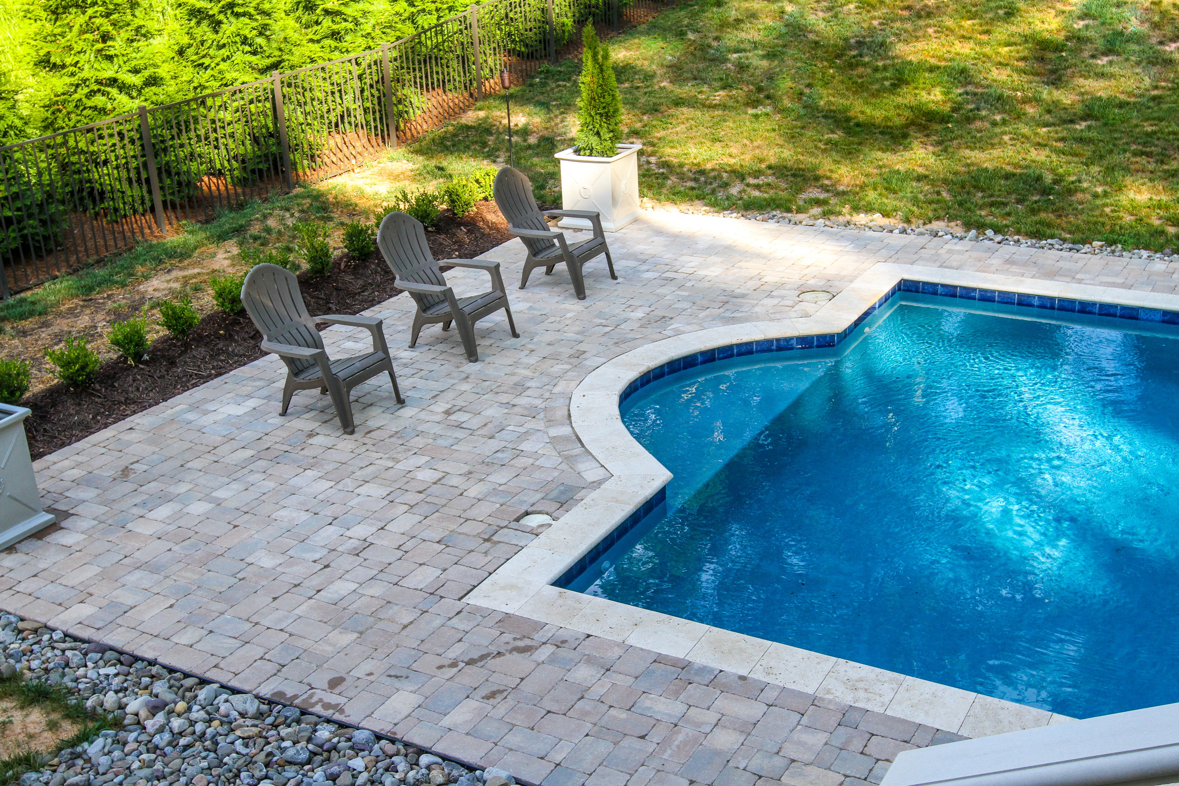 AFTER WITH PAVERS PUT IN:  Pool with firepit, english garden, large patio areas