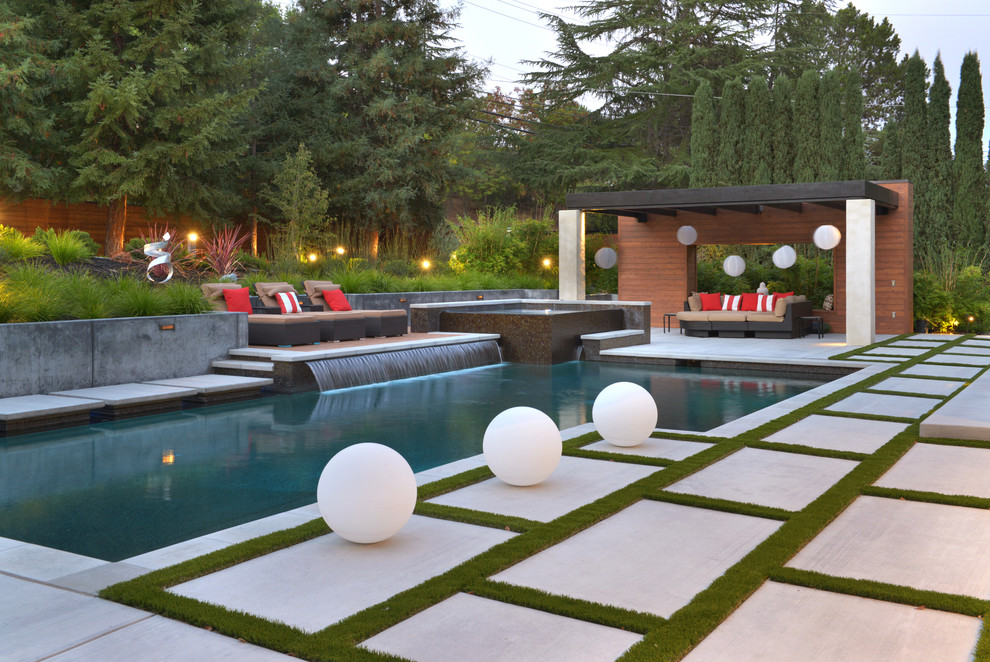 Huge trendy backyard concrete paver and l-shaped hot tub photo in San Francisco
