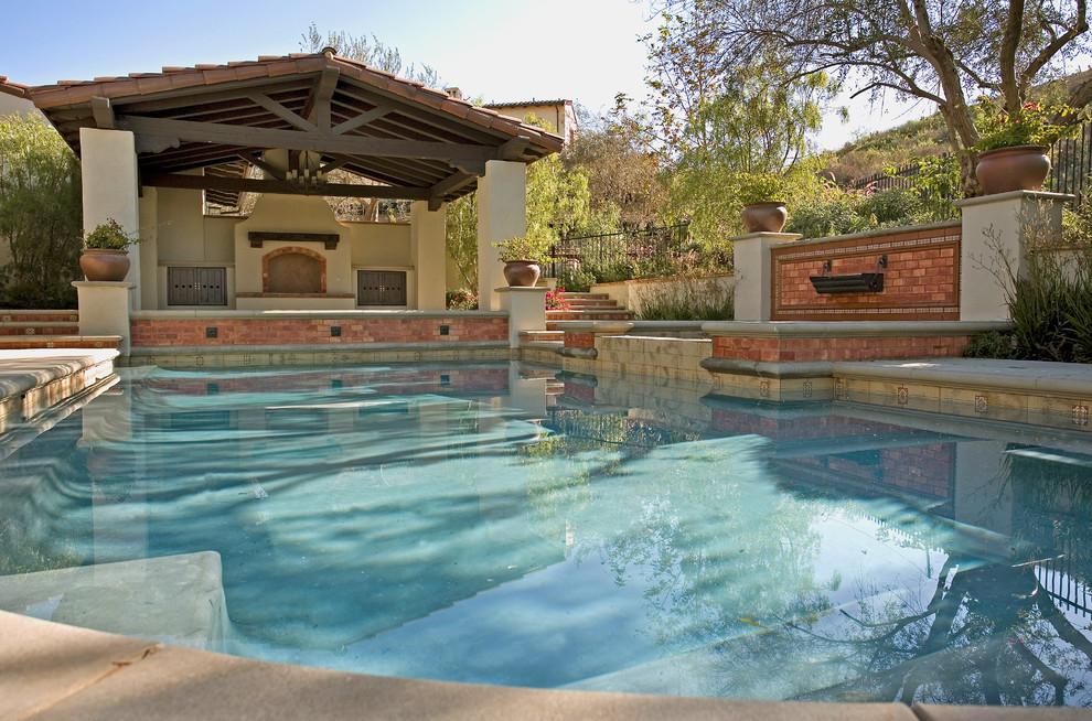 Pool - mediterranean custom-shaped pool idea in Los Angeles
