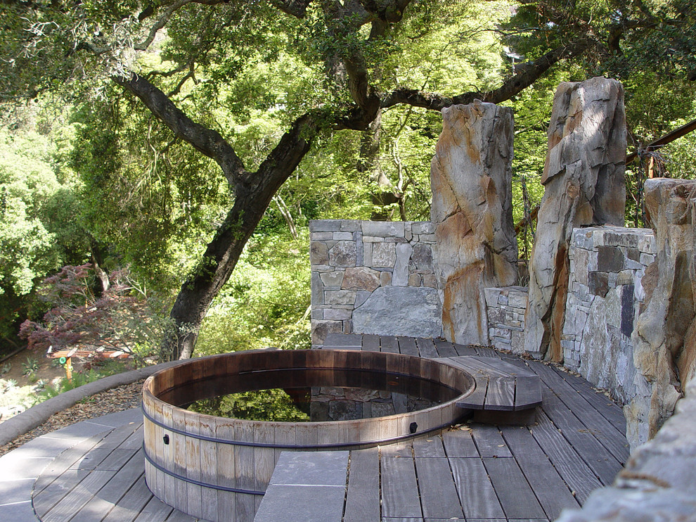 Example of a mid-sized trendy backyard gravel and round aboveground hot tub design in San Francisco