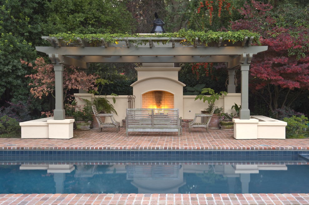 Elegant brick and rectangular pool photo in San Francisco