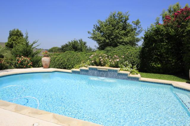 Austin landscape tropical pool austin by melodie for Pool design austin