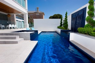 What is the pool surround made of tiles stone or for Swimming pool surrounds design