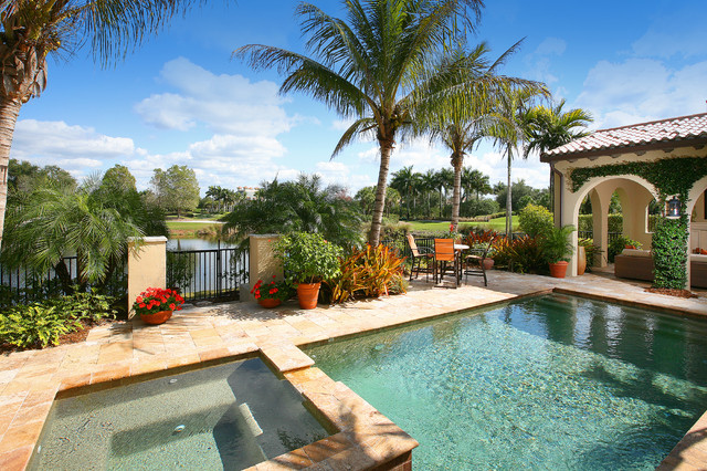 Inspiration for a mediterranean stone pool remodel in Miami