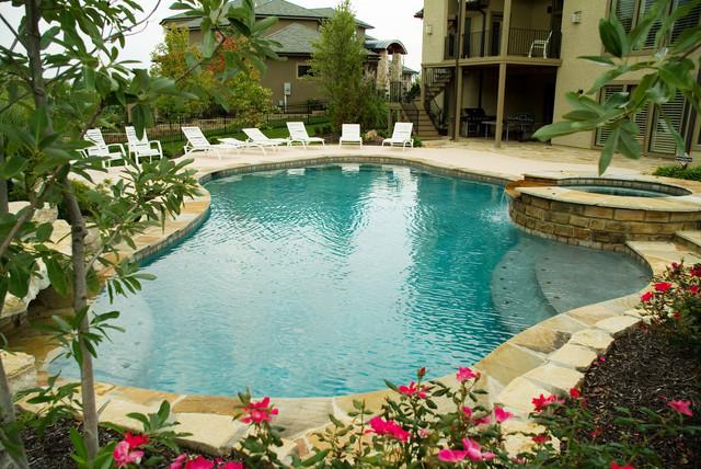 Backyard living tropical pool kansas city by banks for Pool design kansas city