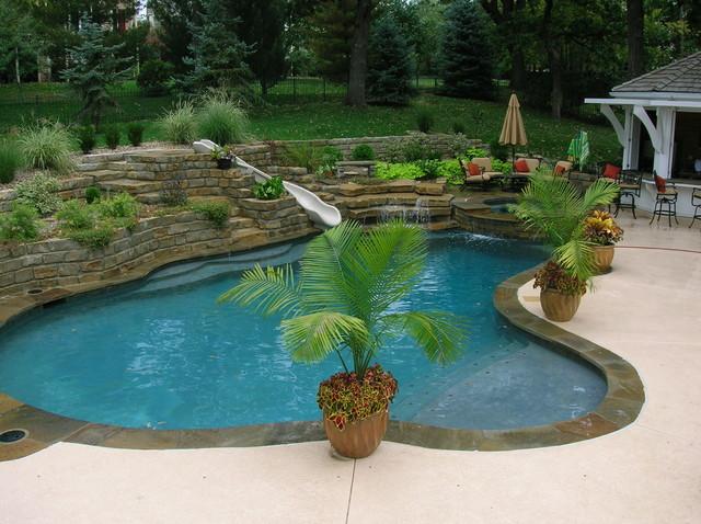 Backyard Living Tropical Pool Kansas city by Banks