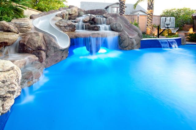 Backyard oasis pool spa swim up bar grotto slides for Swimming pool oasis