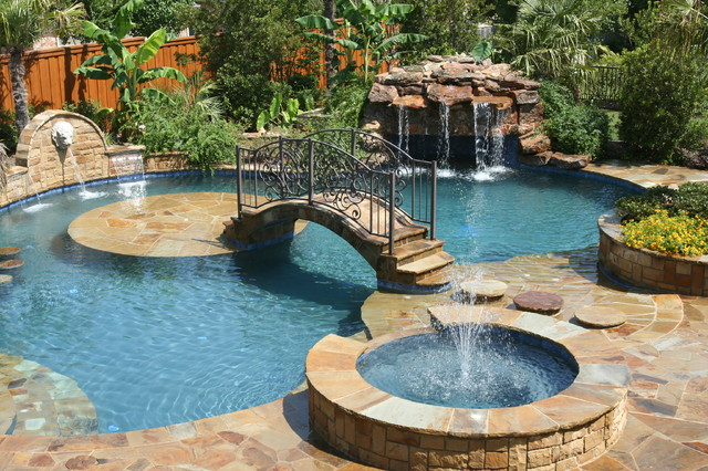 Tropical backyards with a pool home decorating ideas for Big garden pools