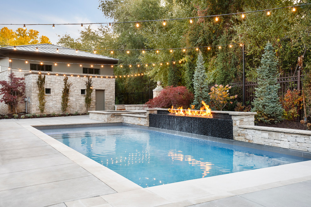 Trendy backyard concrete and rectangular hot tub photo in Salt Lake City