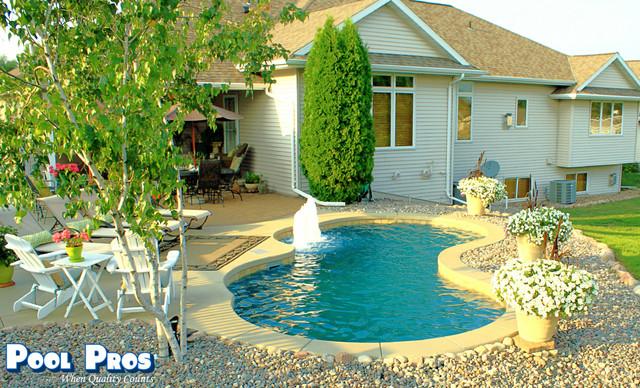 backyard retreat in howard wi   beach style   pool