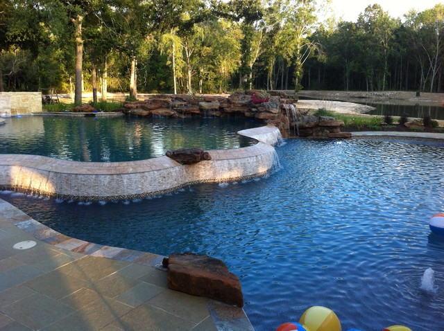 tropical pool by Omega Pools, LLC  281-330-6771