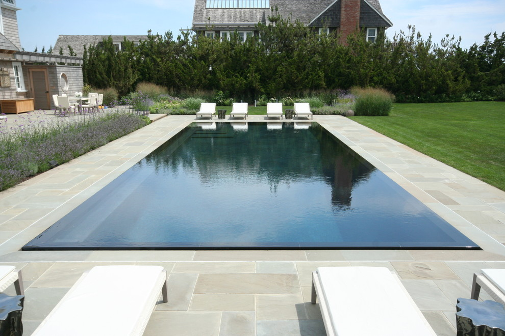Example of a beach style infinity pool design in New York