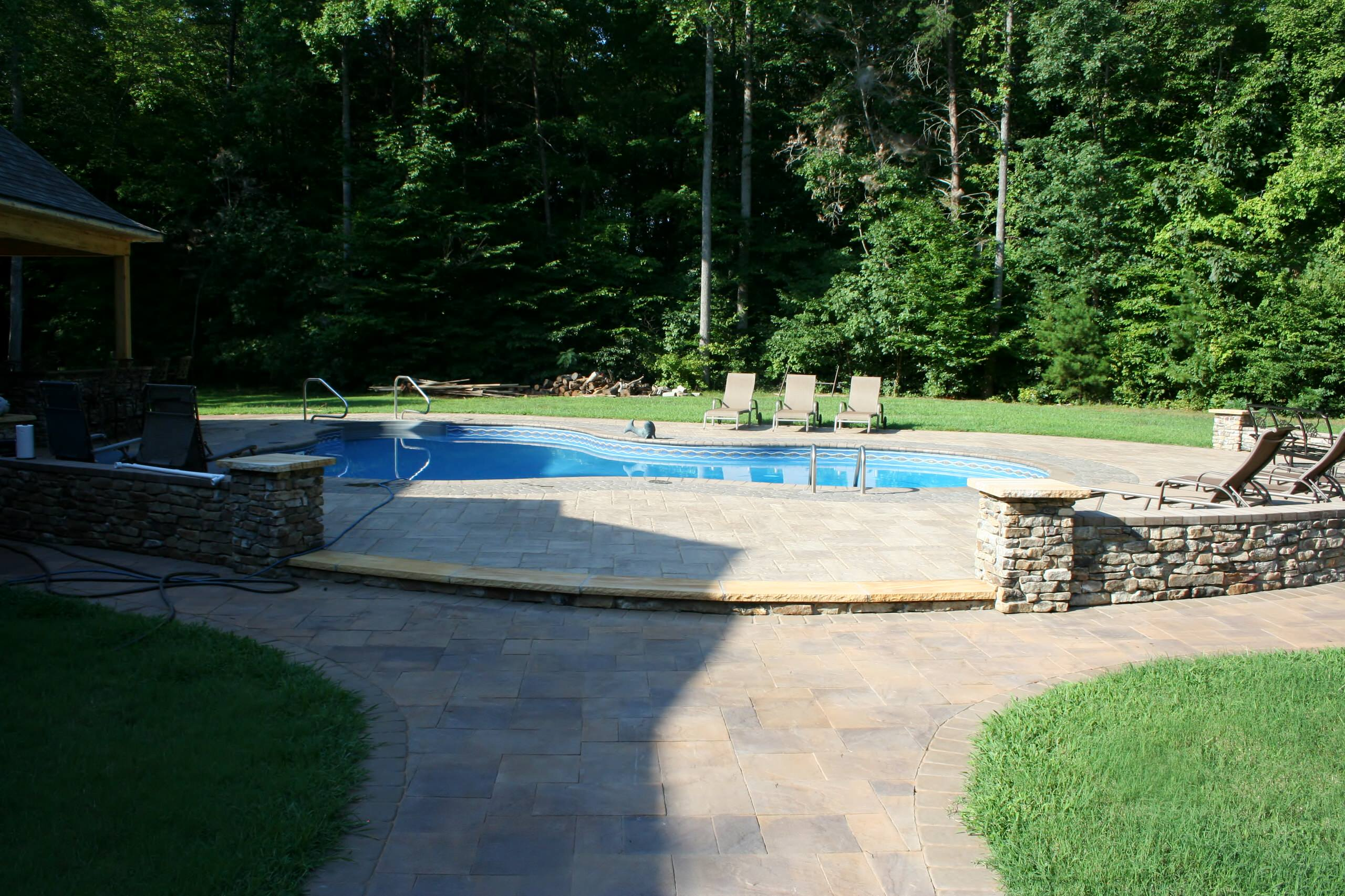 Beautiful Outdoor Living Space around existing pool