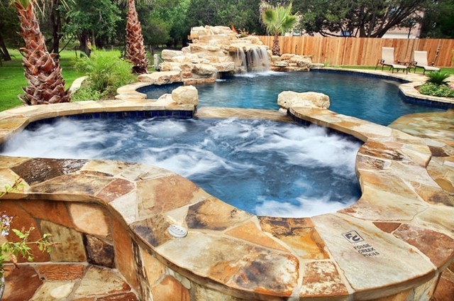 Beautiful Spa With Flagstone Coping Overlooking The Pool