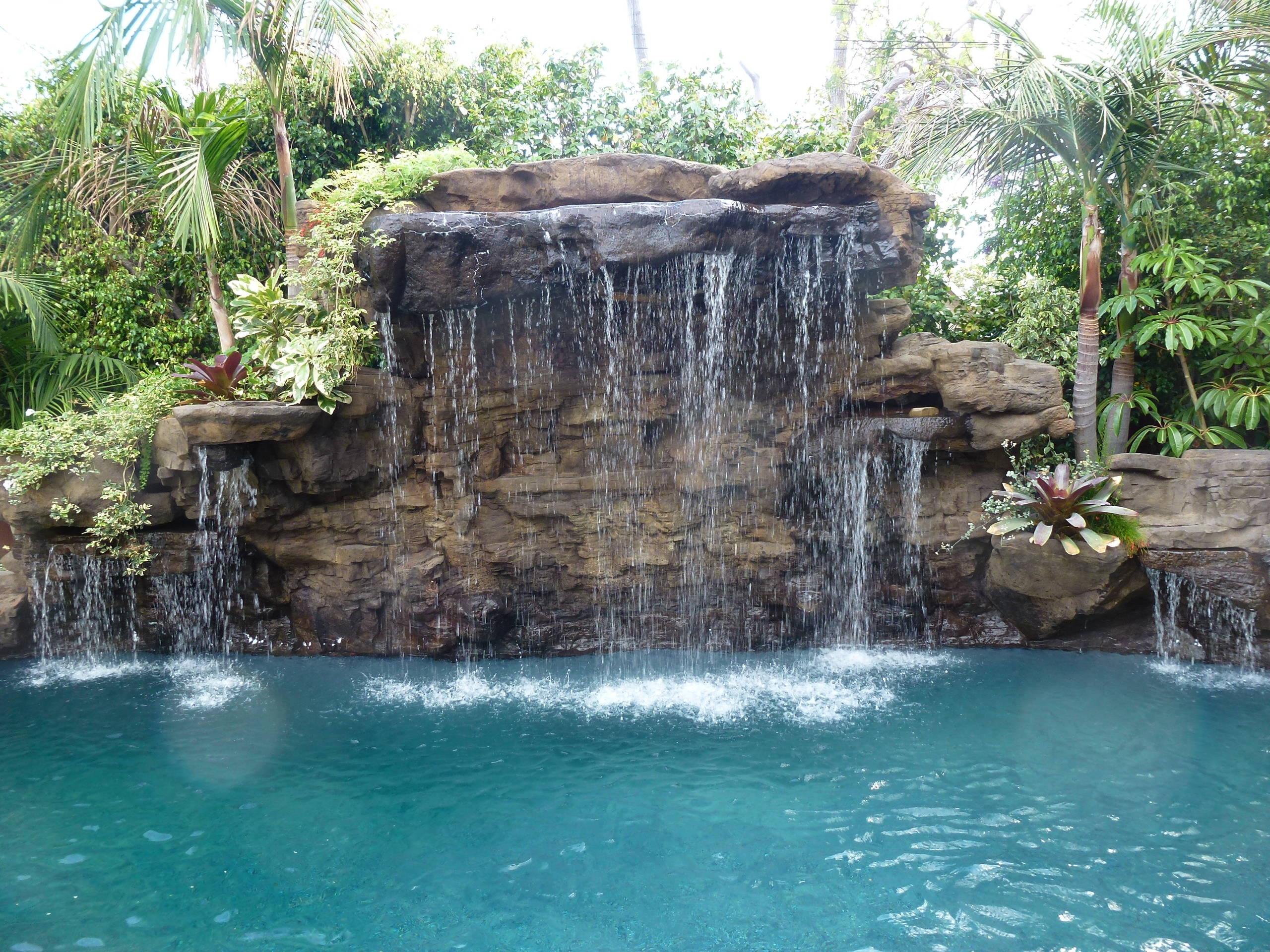 Before & After - Naturalistic Pool with waterfalls & movie screen in West LA, CA