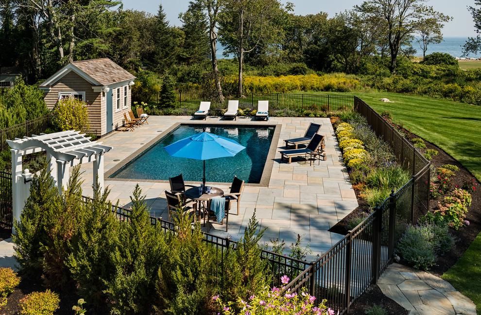 Inspiration for a timeless rectangular pool remodel in Boston